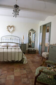 Nostalgic metal bed in the French-style bedroom