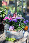 Round basket with asters and budding heather