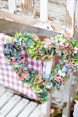 Heart wreath made from hydrangea blossoms and snowberries