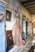 Wall hanging with painting of woman in vintage-style living room