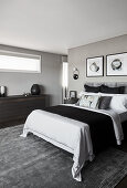Classic, elegant, hotel-style bedroom decorated in shades of grey