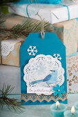 DIY Christmas card with bird motif in blue and white