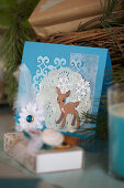 DIY Christmas card with deer motif in blue and white