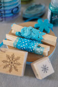 Blue decorative ribbons on clothes pegs