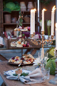 candelabra with burning candles and cake stand