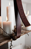 Leather strap holding DIY candle chandelier