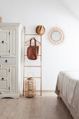 White wardrobe and Mediterranean decorations in bedroom