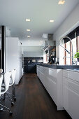 White fitted kitchen with black granite worksurface