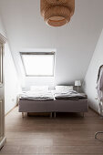 Double bed in attic room