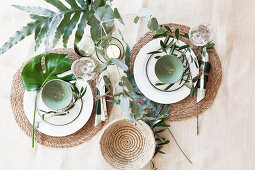 Summery place settings for two with Mediterranean greenery