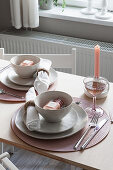 Table set in pastel pink shades