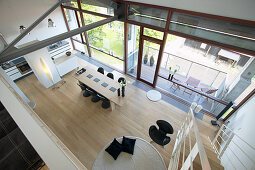 Open-plan interior of loft apartment with glass wall