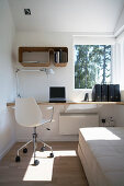 Solid wooden floating desk fitted in niche and white chair