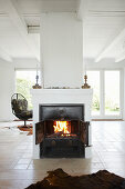 Fireplace in open-plan interior