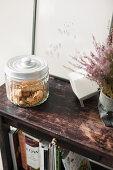 Cookies in glass jar on wooden shelves