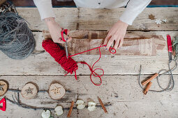 Making Christmas decorations from wooden discs and wool