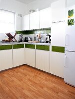 White kitchen with a green stripe