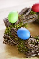 Coloured Easter eggs on willow wreath