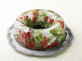 A ring of ice with berries and leaves