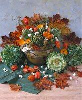 Autumn arrangement of artichokes, ornamental cabbage & marigolds