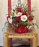 Arrangement of raspberries, mallow, poppy seed capsules & roses