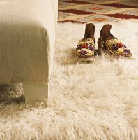 Shoes on flokati rug