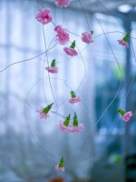 Flowers threaded on wire