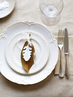 White place-setting with leaves