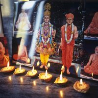 Religious paintings by candlelight (India)