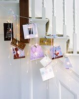 Christmas cards and fairy lights on banister rails