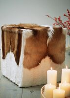 Cube stool covered with animal skin