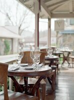 Laid tables on veranda of a restaurant (USA)
