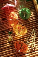 Open Cocktail Umbrellas with Toothpicks on a Bamboo Tray