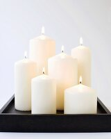 Six Burning Candles on a Wooden Tray