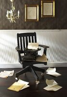 Black Chair with Typewriter; Scattered Papers