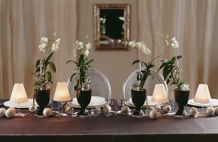 A table laid for Christmas with white orchids