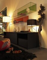 Lighting above a sideboard and a glass tank on a wall