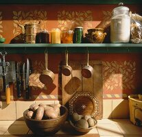 Preserving jars and potatoes on a kitchen shelf