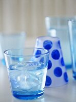 Blue tinted glass containing iced water.