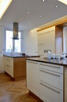 Double central island units in contemporary kitchen