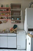 Shelving above fitted unit in modern kitchen
