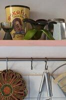 Stainless steel bar for hanging utensils