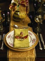 Festive place-setting with orchid