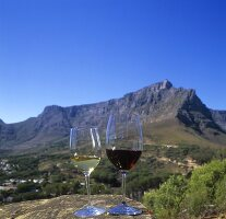 Wine glasses on a rock with view of Cape Town, S. Africa