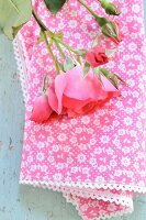 Pink roses on a cloth