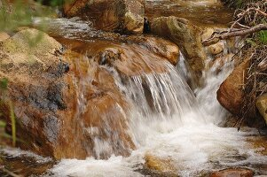 A waterfall cascading into a river