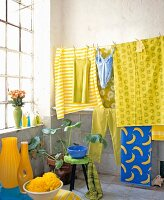 Tiled room with colourful laundry hanging on line