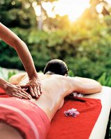 Woman having back oiled and massaged