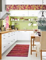 White kitchen-dining room with green and purple accents