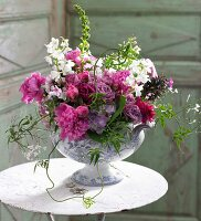 A luxuriant bunch of summer flowers in a porcelain bowl